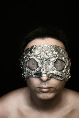 Freak in foil mask and reticulated facet eye covers on black