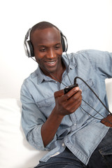 Cheerful man listening to music