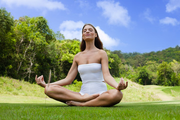 Quiet young woman practicing yoga's pranayama