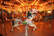 Beautifully decorated carousal horses on a merry-go-round