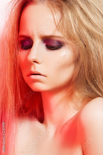 Beauty portrait of fashion model with dark evening make-up