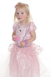 cute girl in pink princess dress tentatively looking at camera