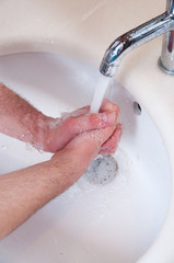 Close up view of a male washing hands