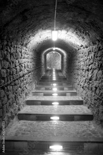Foto op Aluminium Tunnel Ibiza island tunnel way up to the castle light effect