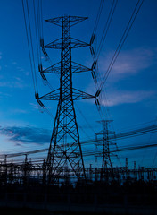 High voltage electricity pillars and blue sky before sunrise