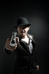 Angry gangster is shouting and pointing a gun