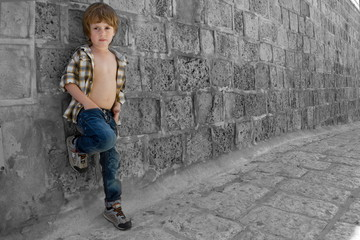 Portrait of five years old boy outdoors in the old city
