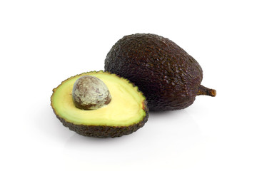 Whole and half avocados