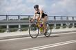 Triathlete biker pedaling on race bicycle