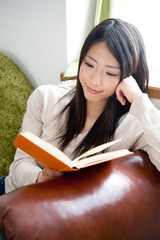 beautiful asian woman reading a book
