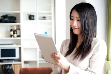 beautiful asian woman using a tablet computer