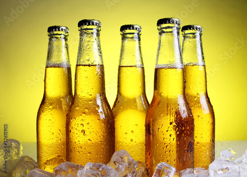 Bottles of cold and fresh beer with ice - 32618903