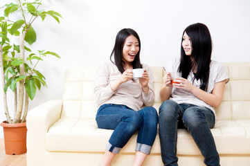 beautiful asian women relaxing on the couch