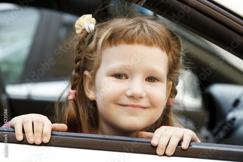Cute little girl in a car
