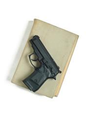 Gun and book