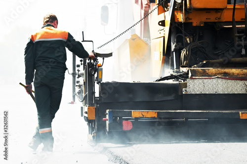 worker at asphalting works