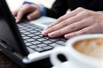 hands typing on lap top
