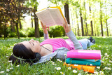 Fototapety relaxing in nature with book and music