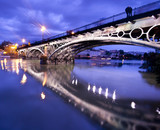 Fototapety Sevillie, romantic panorama of the bridge and the riverside