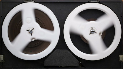 Open reel audio tape recorder reels spinning