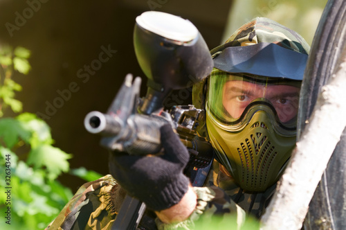 paintball player with gun