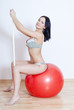 Woman witt fitball and toning bar
