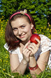 Girl with apple on grass