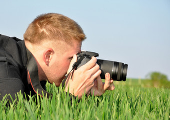 photographer with SLR camera