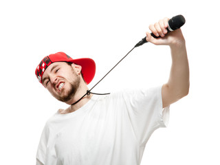 A young guy with a beard strangles himself microphone.