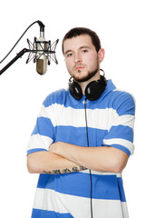 young guy with a beard in the headphones and microphone.