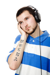 young guy with a beard, headphones.