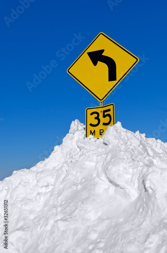 Snow Surrounding Curve Road Sign