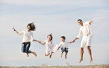 happy young family have fun on beach - Fine Art prints