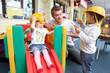 Leinwandbild Motiv Man with children playing together
