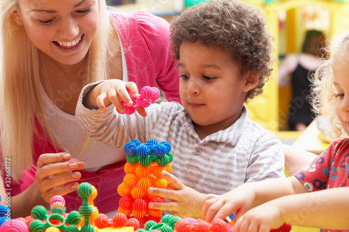 Leinwanddruck Bild Young woman playing with boy