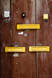 a door with doorbells and mailboxes