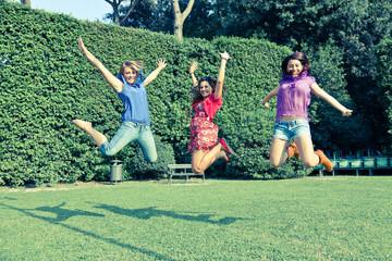 Happy Teenage Female Friends Jumping
