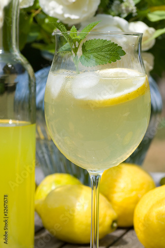 Cocktail with lemons and limoncello