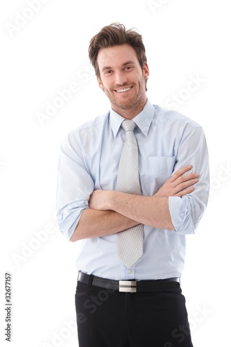 Handsome businessman smiling confidently