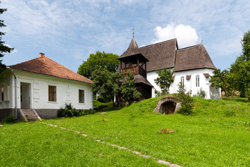Church, wood belfry and old  rectory house
