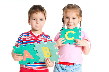 boy and girl holding letters