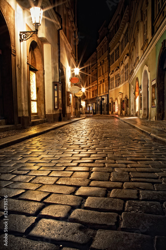 Poster narrow alley with lanterns in Prague at night