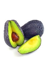 A selection of haas avocado fruit on white background