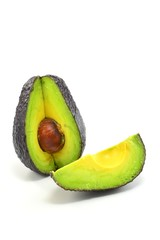Haas avocado fruit sliced on a white background