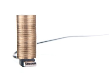 Golden coins stack on USB cable