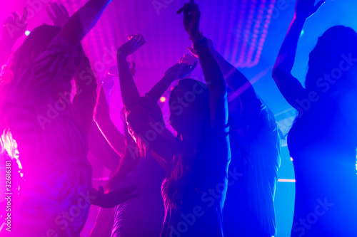 Party people dancing in disco club - 32686381