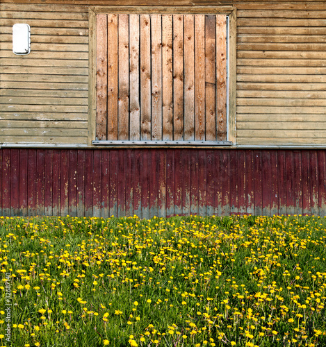 old russian style exterior with old painted wooden planks buildi