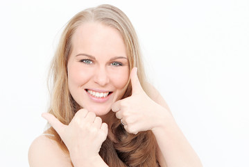 blonde smiling woman with thumbs up looking happy