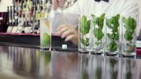 barman preparing mojito in pub