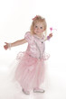 pretty little girl in pink fairy dress dancing